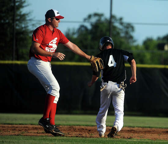 Mid County's Zach Smith is tagged out while trying to steal second during an exhibition game against alumni players at Nederland High School in Nederland, Tuesday, July 24, 2012. Tammy McKinley/The Enterprise Photo: TAMMY MCKINLEY