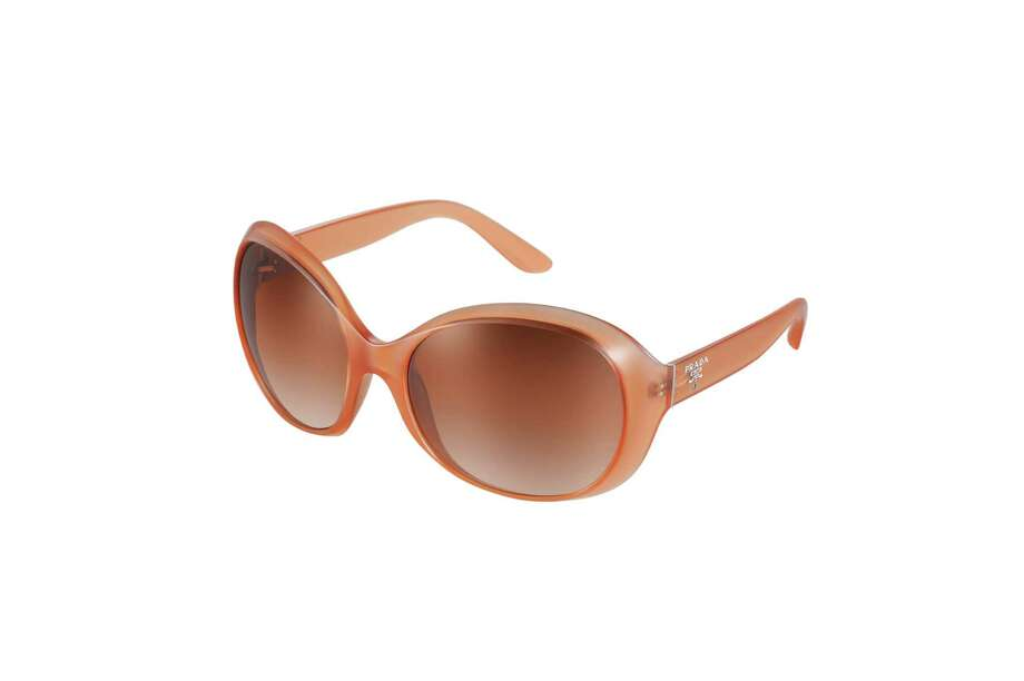 SLEEK: Go chic and sleek with these Prada sunglasses in a yummy melon hue, $245 at Sunglass Hut. Photo: Sunglass Hut