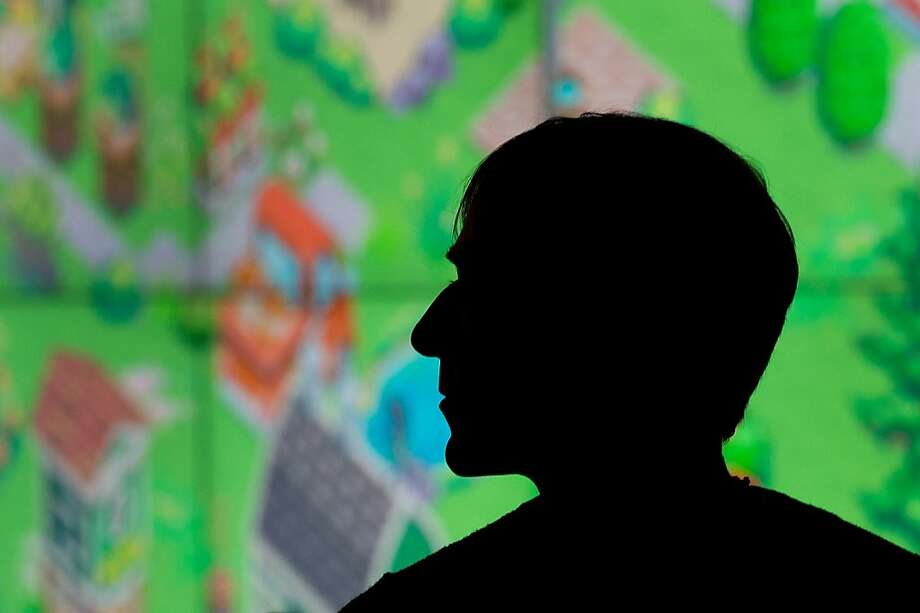 Mark Pincus, chairman and chief executive officer of Zynga Inc., watches a presentation during an event at Zynga Inc. headquarters in San Francisco, California, U.S., on Tuesday, June 26, 2012. Zynga Inc. introduced a social-networking service designed to make it easier for users to play online games across different mobile devices and existing sites. Photographer: David Paul Morris/Bloomberg *** Local Caption *** Mark Pincus Photo: David Paul Morris, Bloomberg