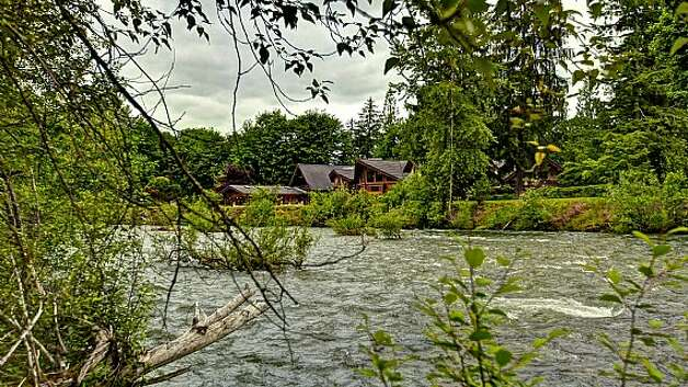 View from across Snoqualmie River of a Snoqualmie home set for sale at auction on Aug. 9. Photo: J. P. King Auction Co.