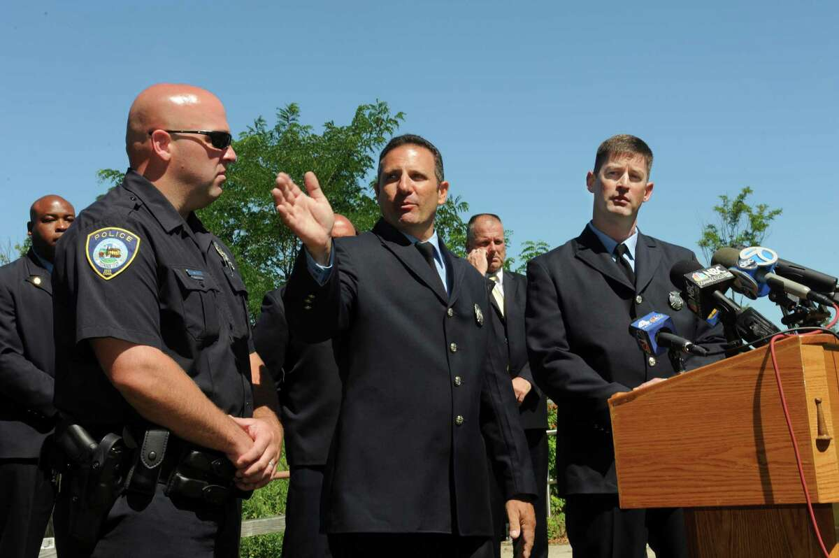 Darien police diver Dan Ehret left, and Stamford fire rescue divers Joe Maida and Bill O'Connell speak during the press conference Wednesday, July 25, 2012. The Director of Public Safety, Thaddeus Jankowski holds a press conference to laud his Fire Department Dive Team and regarding the boating accident at the Czescik Municipal Marina, in Stamford Wednesday, July 25, 2012.