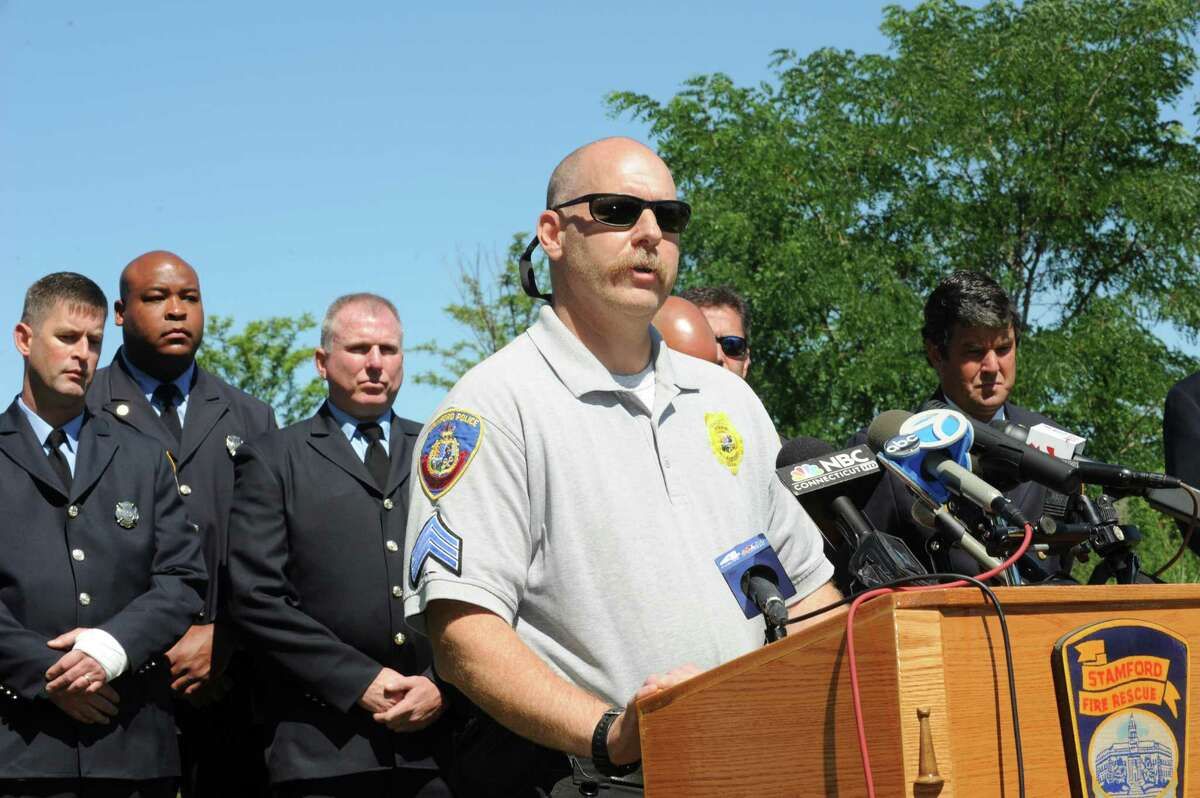 Stamford Police Sgt. Supervisor Pete Wolf speaks at the press conference Wednesday, Jul 25, 2012. The Director of Public Safety, Thaddeus Jankowski holds a press conference to laud his Fire Department Dive Team and regarding the boating accident at the Czescik Municipal Marina.