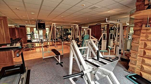 Fitness room of a Snoqualmie home set for sale at auction on Aug. 9. Photo: J. P. King Auction Co.