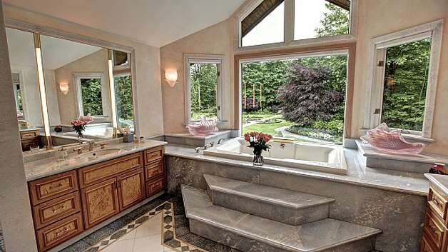 Master bathroom of a Snoqualmie home set for sale at auction on Aug. 9. Photo: J. P. King Auction Co.