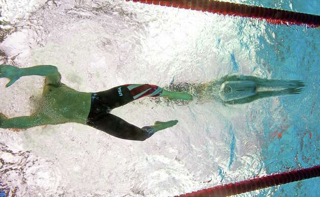 "Michael Phelps' eight medals were partly due to teamwork. This underwater photograph shows Phelps (left) touching the blocks just as final swimmer Jason Lezak dove into the pool during the men's 4x100m medley relay swimming final. Phelps credited his record at the 2008 Olympics to Lezak, who started out behind in the relay. ""(Lezak's) last 50 meters were absolutely incredible,"" Phelps told ESPN.  Photo: FRANCOIS-XAVIER MARIT, Getty Images / 2008 AFP"