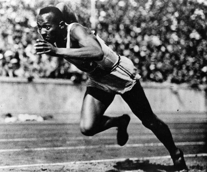 American sprinter and athlete Jesse Owens, who won four gold medals for running and field events in