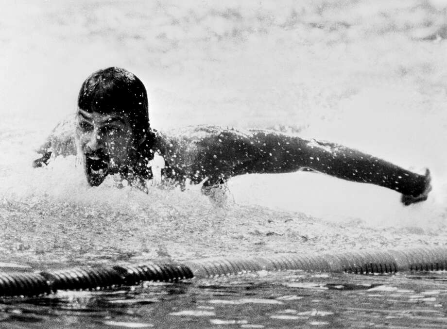 Here, American swimming champion Mark Spitz is pictured in action during the Olympic 200-meter butterfly final event on Aug. 31, 1972 in Munich.  Spitz captured seven swimming gold medals during those games , setting a new record.  Photo: STAFF, Getty Images / 2012 AFP