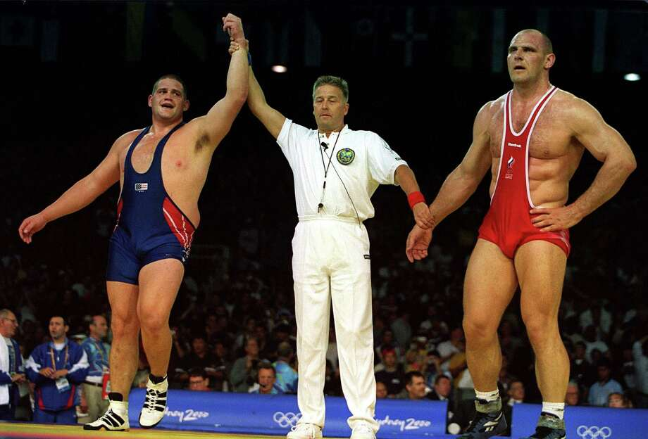 Rulon Gardner of the USA (left) won the gold medal for Greco-Roman wrestling in the Sydney 2000 Olympics, defeating Alexandre Kareline of Russia. Kareline was previously undefeated for 13 years, and Gardner grew up on a Wyoming dairy farm. Photo: Billy Stickland, Getty Images / Getty Images AsiaPac