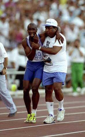 Derek Redmond of Great Britain was helped towards the finish line by his father Jim Redmond at the 1992 Barcelona Games. Redmond suffered a torn hamstring in the 400-meter semifinal and had to leave the track. Photo: Gray Mortimore, Getty Images / Getty Images Europe