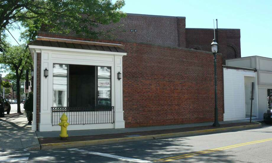 The owner of this building at the corner of Post Road and Sanford Street, once the home of Las Vetas Lounge and the prospective home of a new restaurant, was granted permission by the Town Plan and Zoning Commission to expand support services into a neighboring storefront on Sanford Street instead of a second story. Photo: Genevieve Reilly