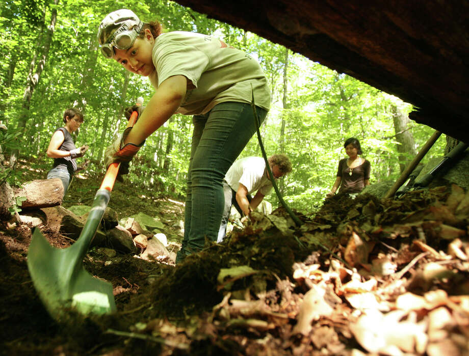 Kalina Nelson, 17 of Kingston, NY, works with her fellow LEAF interns to create an erosion fighting water bar across a trail at Devil's Den preserve in Weston on Wednesday, July 25, 2012. Photo: Brian A. Pounds / Connecticut Post