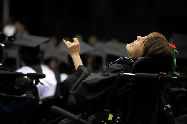 Kassie Sanchez relishes the moment as she sits in the audience during graduation from Clark High School at the Alamodome in San Antonio on Sunday, June 3, 2012. Photo: Lisa Krantz, San Antonio Express-News / San Antonio Express-News