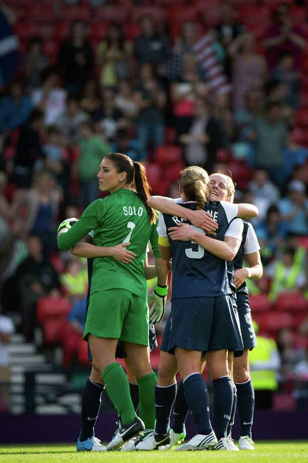 The United States' Rachel Buehler, facing at right, celebrates the Team USA victory over France with Christie Rampone (3) and goalkeeper Hope Solo after a women's first round, group G, football match of the 2012 London Olympics on Wednesday, July 25, 2012, at Hampden Park in Glasgow. Photo: Smiley N. Pool, Houston Chronicle / © 2012  Houston Chronicle