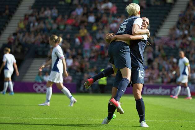 Alex Morgan of the United States (13) celebrates with Megan Rapinoe after scoring a goal during the first half against France during a women's first round, group G, football match of the 2012 London Olympics on Wednesday, July 25, 2012, at Hampden Park in Glasgow. Photo: Smiley N. Pool, Houston Chronicle / © 2012  Houston Chronicle