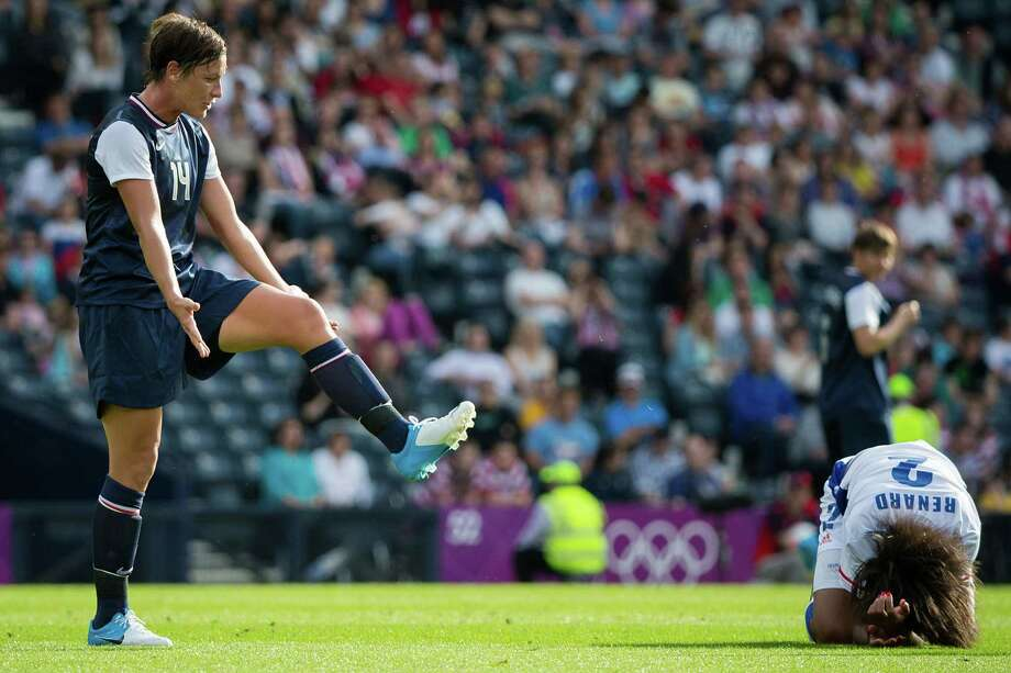 Abby Wambach of the United States, left, argues for a penalty after a collision with France's Wendie Renard during a women's first round, group G, football match of the 2012 London Olympics on Wednesday, July 25, 2012, at Hampden Park in Glasgow. Photo: Smiley N. Pool, Houston Chronicle / © 2012  Houston Chronicle