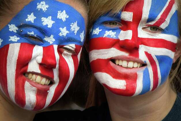Fans of Team USA paint their faces with a combination of American and British flags to watch the USA take on France in a women's first round, group G, football match of the 2012 London Olympics on Wednesday, July 25, 2012, at Hampden Park in Glasgow. Photo: Smiley N. Pool, Houston Chronicle / © 2012  Houston Chronicle