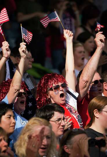 Fans of Team USA as their team takes on France in a women's first round, group G, football match of