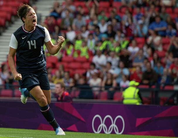Abby Wambach of the United States celebrates after scoring a goal against France during a women's first round, group G, football match of the 2012 London Olympics on Wednesday, July 25, 2012, at Hampden Park in Glasgow. Photo: Smiley N. Pool, Houston Chronicle / © 2012  Houston Chronicle