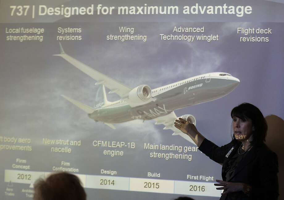 In this June 14, 2012 photo, Beverly Wyse, Boeing Commercial Airplanes' 737 vice president and general manager, talks to reporters in Renton, Wash., as she stands in front of a projected image of the new 737 MAX airplane during a briefing ahead of the Farnborough International Airshow. United Airlines and Boeing announced Thursday, July 12, 2012, that United is buying 150 Boeing 737s, and is planning to use them to replace older planes that are not as fuel efficient. (AP Photo/Ted S. Warren) Photo: Ted S. Warren, Associated Press