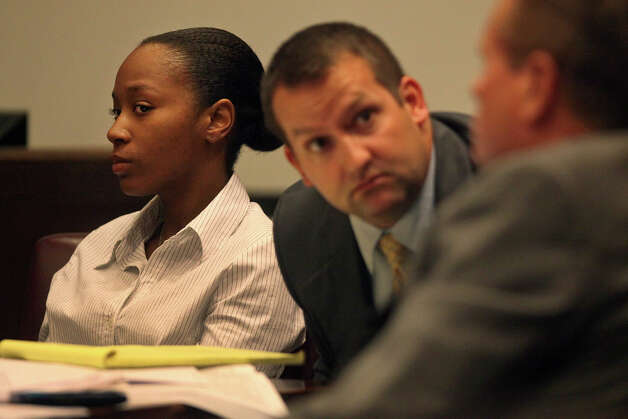 Defendant Tiffany James sits as her defense attorneys Robert Gebbia, center, and Bill Reece confer during James' murder trial for the death of Antwan Wolford in the Bexar County 399th District Court in San Antonio on Wednesday, July 25, 2012. Photo: Lisa Krantz, San Antonio Express-News / San Antonio Express-News