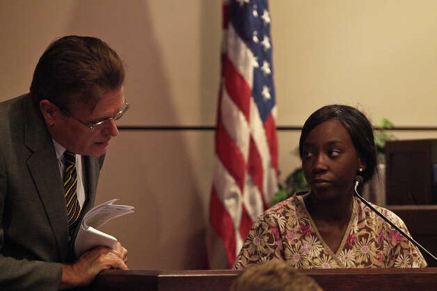Defense Attorney Bill Reece questions Shayla James as she testifies during the murder trial for her sister, Tiffany James, who is charged with the death of Antwan Wolford, in the Bexar County 399th District Court in San Antonio on Wednesday, July 25, 2012. Photo: Lisa Krantz, San Antonio Express-News / San Antonio Express-News