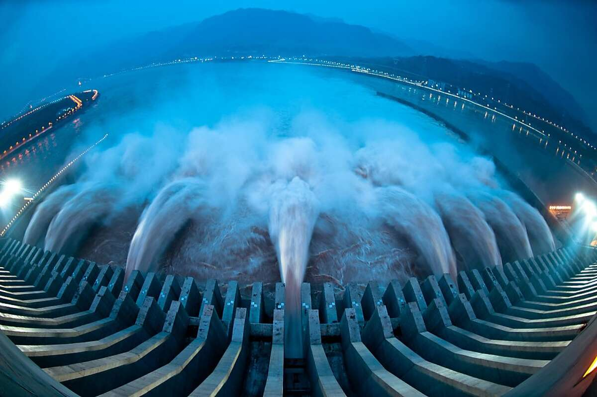TOPSHOTS This picture taken on July 24, 2012 shows water released from the Three Gorges Dam, a gigantic hydropower project on the Yangtze river, in Yichang, central China's Hubei province, after heavy downpours in the upper reaches of the dam caused the highest flood peak of the year. Weekend floods in Beijing caused