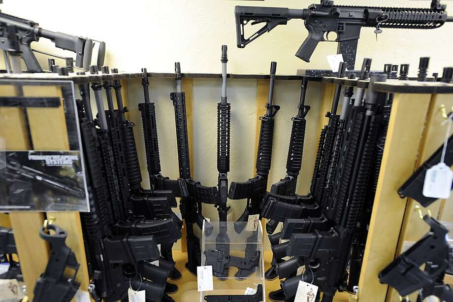 An assortment of semi-automatic rifles are seen in a display at Gary Kolander's shop Gun Vault in Mountain View, CA Wednesday July 25th, 2012. Photo: Michael Short, Special To The Chronicle