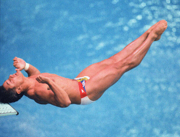 Two-time Los Angeles gold medalist Greg Louganis of the U.S. banged his  head against the board after mistiming his dive during an Olympic  competition in 1988 in Seoul. Louganis nonetheless qualified  for the final.