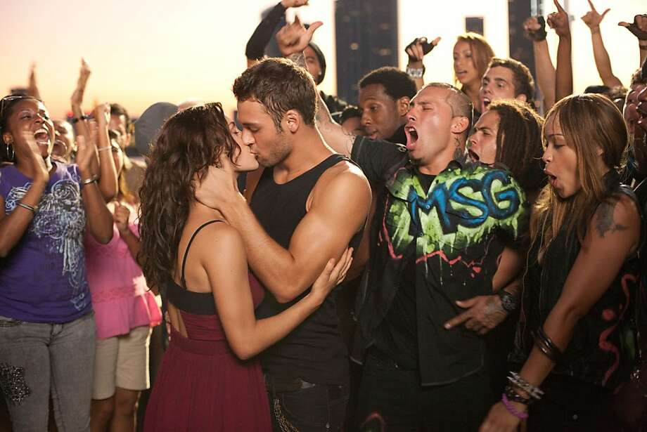 "This film image released by Summit Entertainment shows Kathryn McCormick, left, and Ryan Guzman a scene from ""Step Up Revolution."" (AP Photo/Summit Entertainment, Sam Emerson) Photo: Sam Emerson, Associated Press"