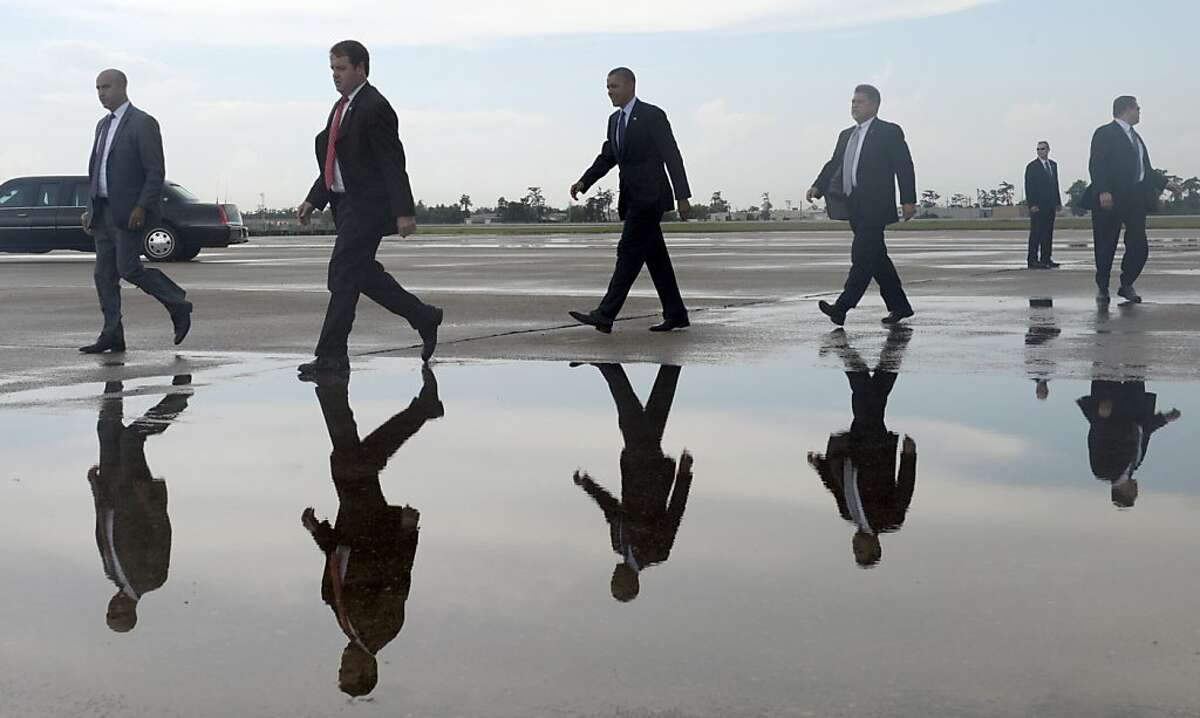 President Barack Obama walks over to greet people after arriving at Louis Armstrong International Airport in New Orleans, Wednesday, July 25, 2012. Obama is fundraising in New Orleans and is scheduled to speak to the National Urban League convention. (AP Photo/Susan Walsh)