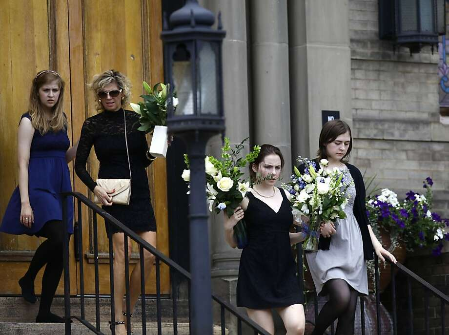"The children of movie-theater-shooting-victim Gordon Cowden leave the memorial service for their father at Pathways Church July 25, 2012 in Denver, Colorado. Twenty-four-year-old James Holmes, suspected of killing Cowden and 11 others and injuring 58, July 20, during a shooting rampage at a screening of ""The Dark Knight Rises"" in Aurora, Colorado.   (Photo by Joshua Lott/Getty Images) Photo: Joshua Lott, Getty Images"