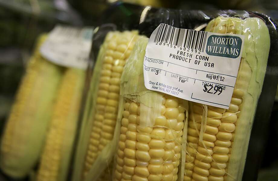 Corn is displayed for sale at a supermarket in New York, U.S., on Wednesday, July 25, 2012. U.S. consumers may pay 3 percent to 4 percent more for food next year, as the effects of the country's worst drought since the 1950s work their way onto supermarket shelves, the Department of Agriculture said in its first forecast for 2013. Photographer: Scott Eells/Bloomberg Photo: Scott Eells, Bloomberg