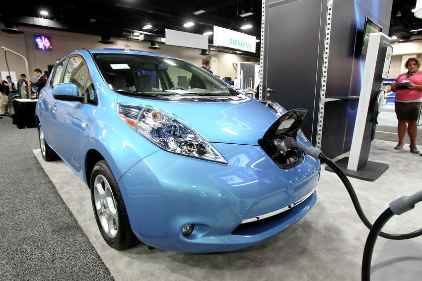 A Nissan Leaf is powered up at the Plug-In-2012 Convention & Expo at the Gonzalez Convention Center on July 25, 2012.