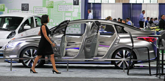Infiniti presents a flashy prototype at the Plug-In-2012 Convention & Expo at the Gonzalez Convention Center on July 25, 2012. Photo: Tom Reel / ©2012 San Antono Express-News