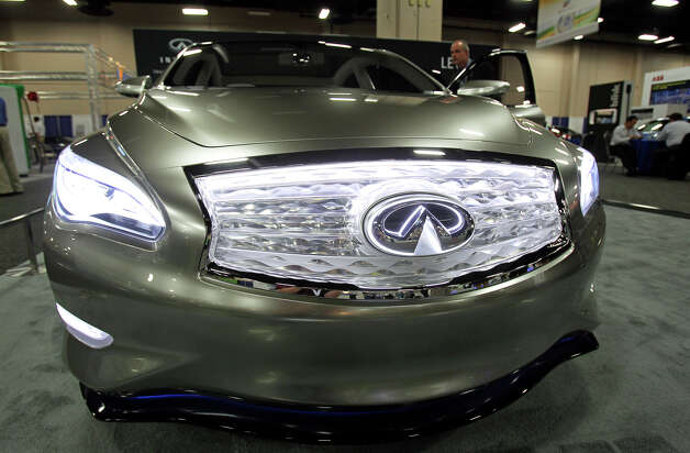 The front clip of the Infiniti is abundantly lit a the Plug-In-2012 Convention & Expo at the Gonzalez Convention Center on July 25, 2012. Photo: Tom Reel / ©2012 San Antono Express-News