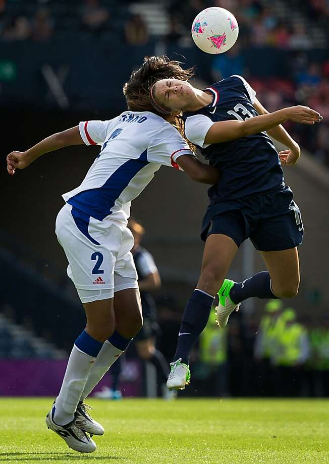 Alex Morgan of the United States fights for a header against France's Wendie Renard during a women's first round, group G, football match of the 2012 London Olympics on Wednesday, July 25, 2012, at Hampden Park in Glasgow. ( Smiley N. Pool / Houston Chronicle) Photo: Smiley N. Pool, Houston Chronicle