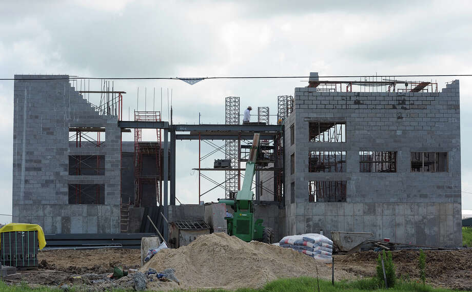 Construction on the Sabine Pass fire station, which was destroyed twice by hurricanes, is expected to be complete by December. The new structure is expected to withstand strong weather better than previous stations. Photo taken Thursday, July 19, 2012 Guiseppe Barranco/The Enterprise Photo: Guiseppe Barranco, STAFF PHOTOGRAPHER / The Beaumont Enterprise
