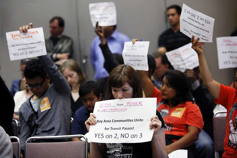 Aspen Dominguec, center, holds up a sign showing her support for free Muni fares for low-income youth while the Metropolitan Transportation Commission considers the issue in Oakland, Calif. on Wednesday, July 25, 2012. Photo: Sonja Och, The Chronicle