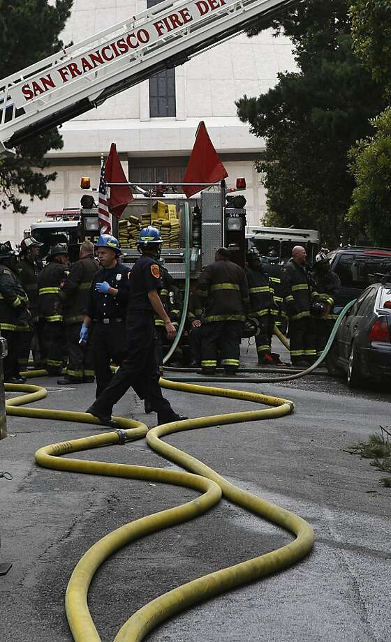 San Francisco fire department responded to a two-alarm fire at an apartment building near St. Mary's Cathedral at 66 Cleary Court  in San Francisco, Calif.,  at 9:50am on Wednesday, July 25, 2012. Photo: Liz Hafalia, The Chronicle
