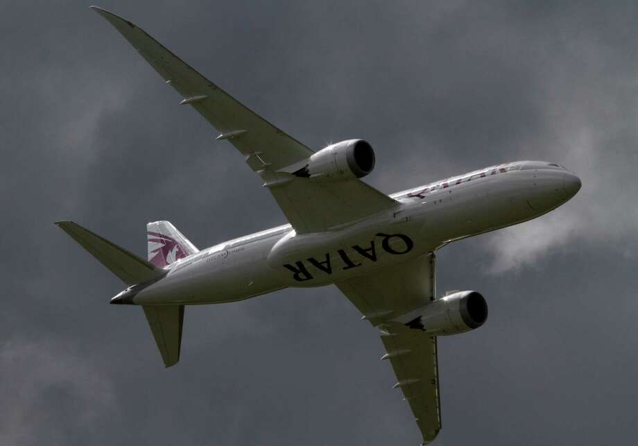 FILE- In this Wednesday, July 11, 2012, file photo, a Qatar Airways Boeing 787 Dreamliner takes off during a display at the Farnborough International Airshow, in Farnborough, England. Boeing Co. posted an unexpected 3 percent improvement in second-quarter net income on strong sales of commercial airplanes. The results surprised Wall Street, and the company raised its earnings forecast for the year. The results announced before the markets opened Wednesday, July 25, 2012, eased investors' fears of an imminent slowdown in the company's defense unit, which produces Chinook helicopters and F-18s, among many other aircraft models.(AP Photo/Lefteris Pitarakis, File) Photo: Lefteris Pitarakis