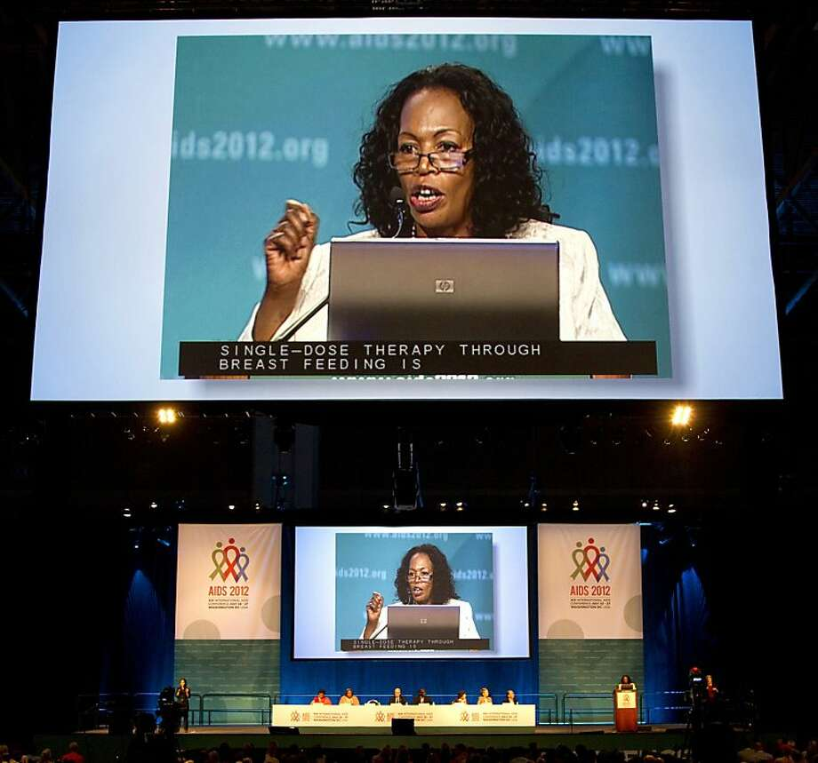 Dr. Chewe Luo tells the AIDS conference that more infected women must get AIDS drugs during pregnancy and nursing. Photo: Carolyn Kaster, Associated Press