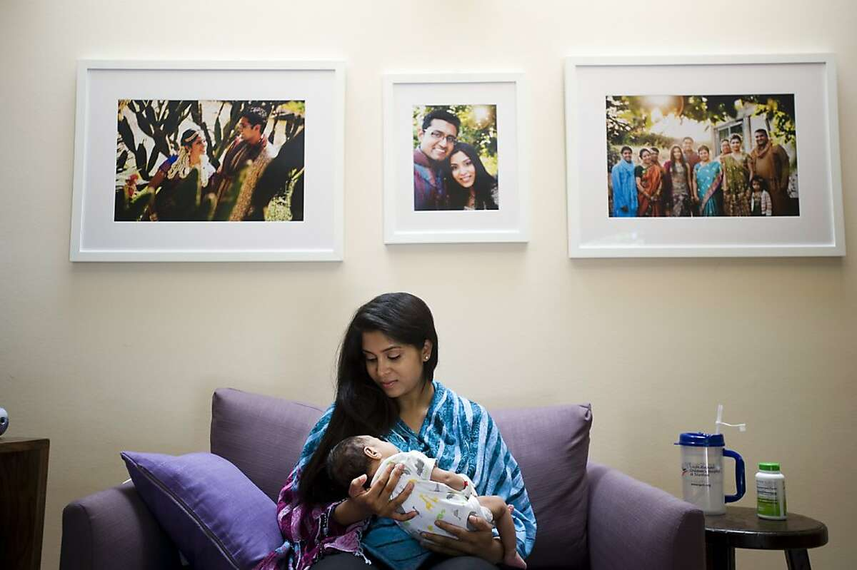 Pooja usually works from a laptop while sitting in a large comfortable armchair in the office she shares with her husband. Pooja Sankar started working from home 5 days after giving birth to her son Arjun. Palo Alto, CA Wednesday July 25th, 2012.