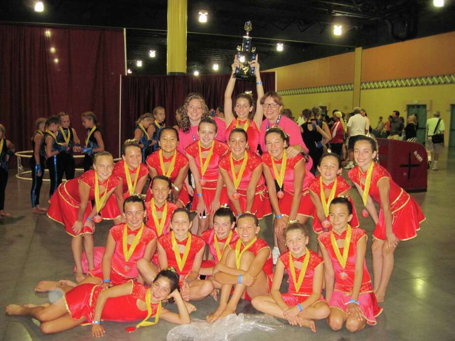 The Westport Weston Family Y's exhibition gymnastics team had plenty to smile about in Orlando after capturing a gold medal in a U.S. Gymnastics Federation competition and earning an invitation to represent the U.S. at a competition in South Africa next summer. Photo: Contributed Photo / Westport News contributed