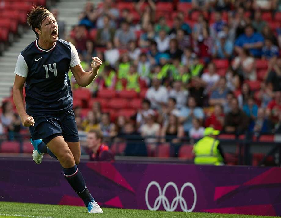 Abby Wambach of the United States celebrates after scoring a goal against France during a women's first round, group G, football match of the 2012 London Olympics on Wednesday, July 25, 2012, at Hampden Park in Glasgow. ( Smiley N. Pool / Houston Chronicle) Photo: Smiley N. Pool, Houston Chronicle