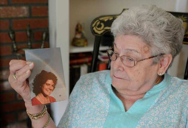 Barbara Huff looks at an image of her daughter Stephanie Diamond, who died earlier this month, at her home in Clifton Park, N.Y. July 24, 2012.     (Skip Dickstein/Times Union) Photo: Skip Dickstein / 00018570A