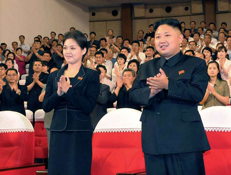 "FILE - This is a file photo made available on Monday July 9, 2012  by the Korean Central News Agency (KCNA) and distributed in Tokyo by the Korea News Service of North Korean leader Kim Jong Un,  right, and   Ri Sol Ju as they clap with others during a  performance by North Korea's new Moranbong band in Pyongyang, North Korea earlier in July. North Korea's new, young leader Kim Jong Un is married, state TV reported Wednesday July 25, 2012 for the first time in a brief and otherwise routine announcement that ends weeks of speculation about a beautiful woman who has accompanied him to recent public events.  Kim toured an amusement park with his ""wife, comrade Ri Sol Ju"" on Tuesday, while a crowd cheered for the leader, the news anchor said without giving any more details about Ri, including how long they had been married.  (AP Photo/Korean Central News Agency via Korea News Service, File) Photo: Uncredited / KCNA VIA KNS"