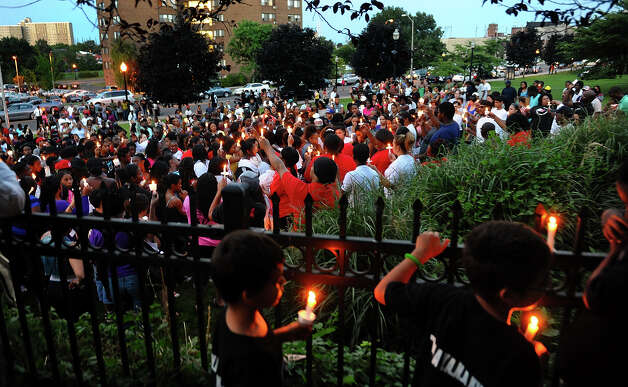 Hundreds of area residents came out to take part in a prayer vigil at Majestic Park in Bridgeport, Conn. on Wednesday July 25, 2012. The vigil was held in response to the recent homicides in the city. Photo: Christian Abraham / Connecticut Post