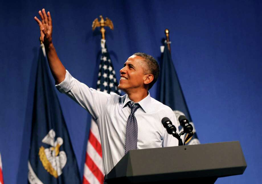 President Barack Obama waves as he arrives to speak at a fundraiser at The House of Blues in New Orleans, Wednesday, July 25, 2012. (AP Photo/Gerald Herbert) Photo: Gerald Herbert / AP