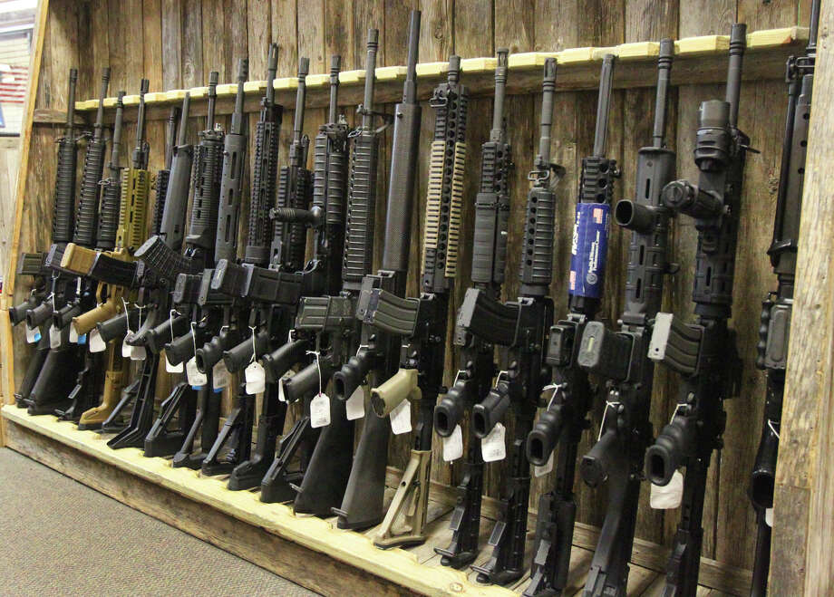 Assault-style rifles are displayed at Dury's Gun Shop on Hot Wells on July 25, 2012.  Photo: San Antonio Express-News