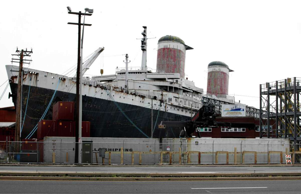 In this July 9, 2012 photo the SS United States is seen moored on the Delaware River in Philadelphia. Caretakers for the legendary ocean liner are renewing and expanding their distress call for the beleaguered piece of American maritime history. (AP Photo/Brynn Anderson)